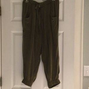 Poleci olive green silk cargo pants.